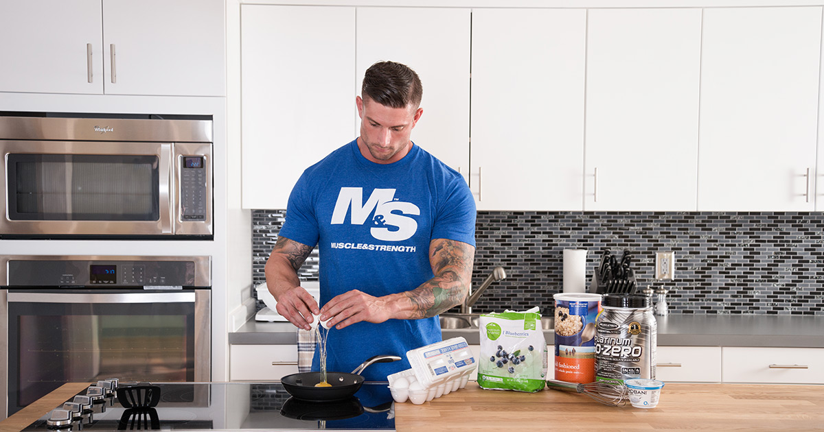 Male athlete in the kitchen cooking