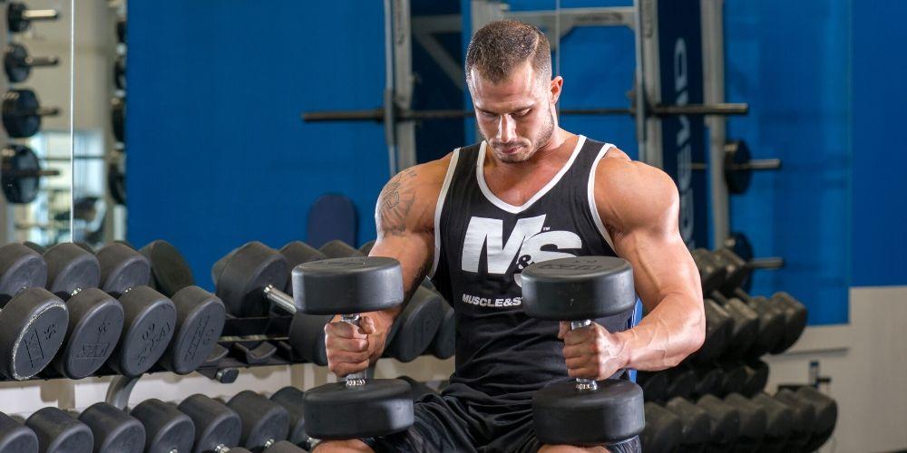 Athletic Man Preparing to Do Shoulder Workout