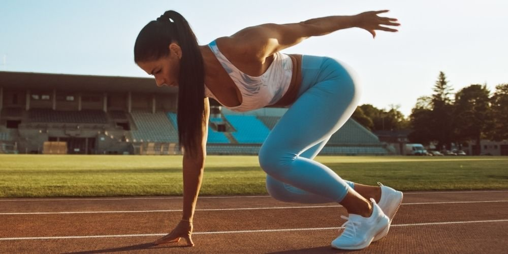 Athletic woman doing sprints outside