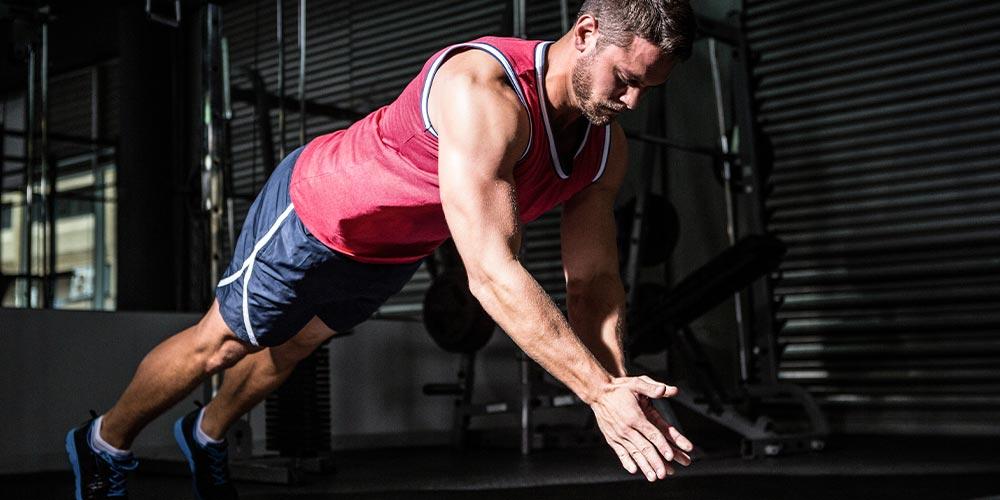 Athletic Man Doing Plyometric Push Up