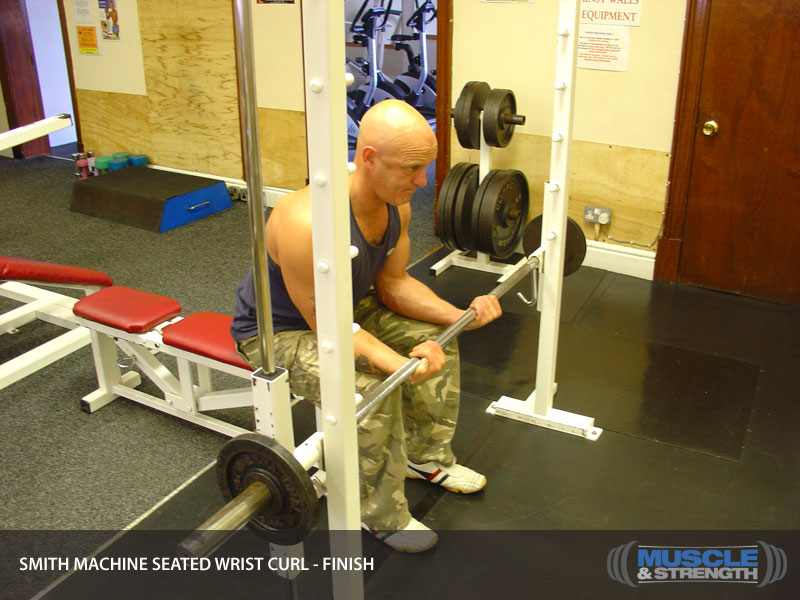 Smith Machine Seated Wrist Curl Video Exercise Guide Amp Tips