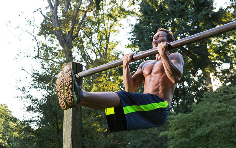Fit man chip ups outdoors