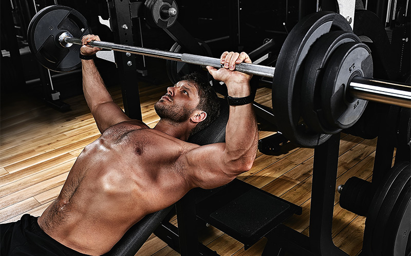 Man performing BB Incline Bench Press