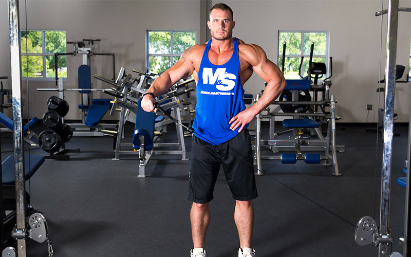 Muscle & Strength Athlete Using Cables for Shoulder Workout