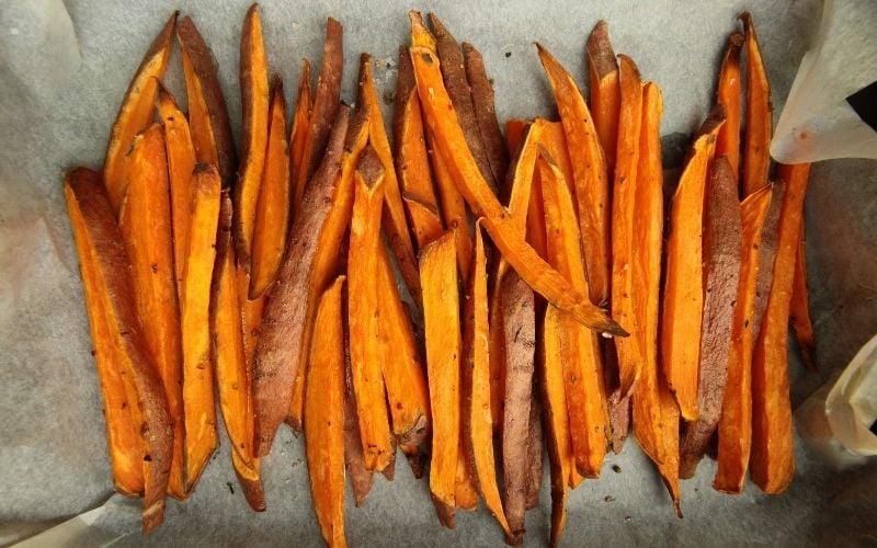 Sweet potato fries on parchment paper.