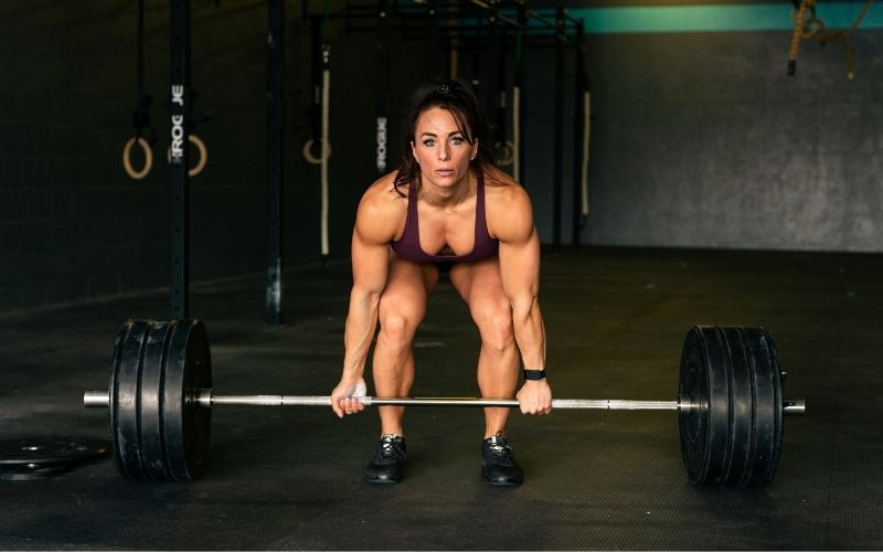 Swolverine athlete setting up to perform a deadlift.