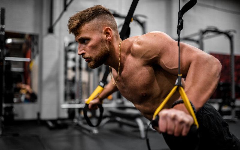 Close up of man doing TRX push ups.