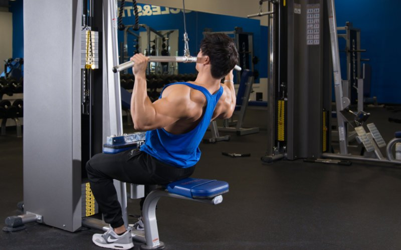 M&S athlete doing lat pulldowns in gym