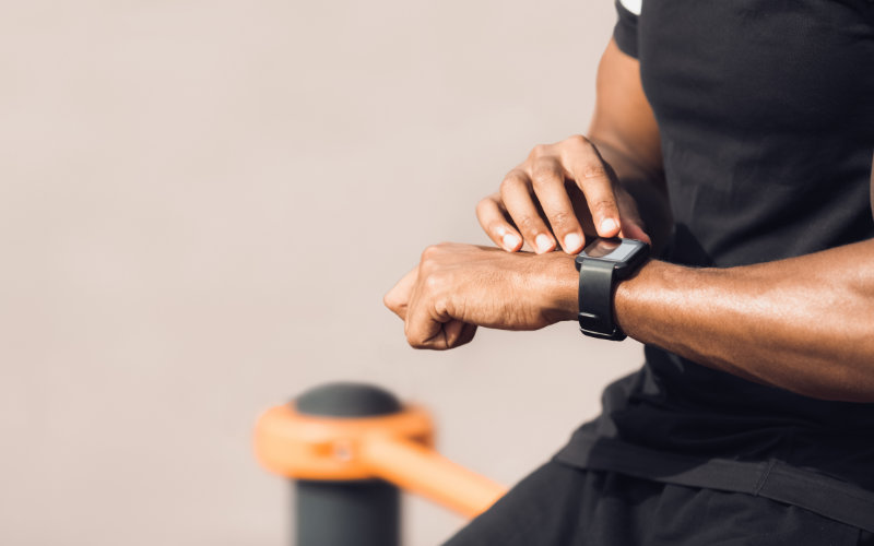 Close up of man checking his smart watch.