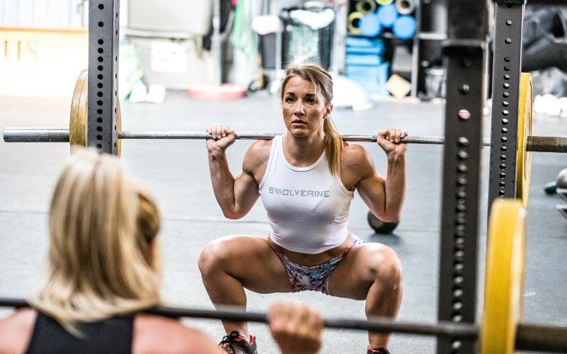 Swolverine athlete doign barbell back squats