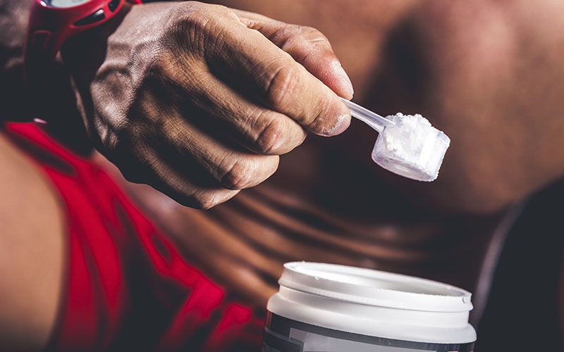 Athlete Scooping Supplements