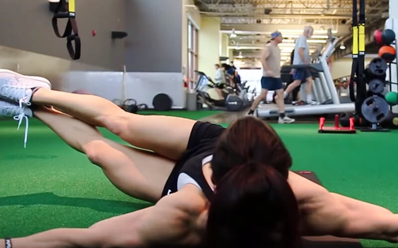 KM Athlete Performing Side Lying Twists