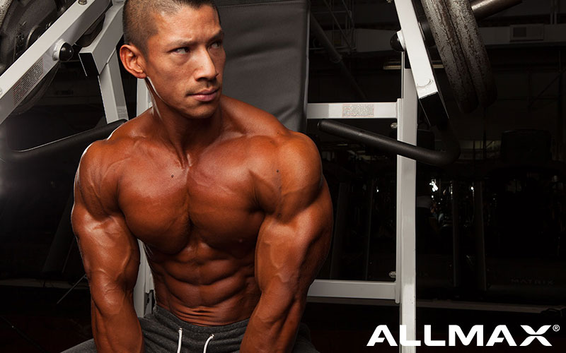 Allmax athlete showing off his 6 pack