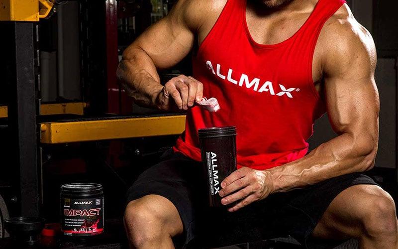 ALLMAX Athlete taking a preworkout supplement