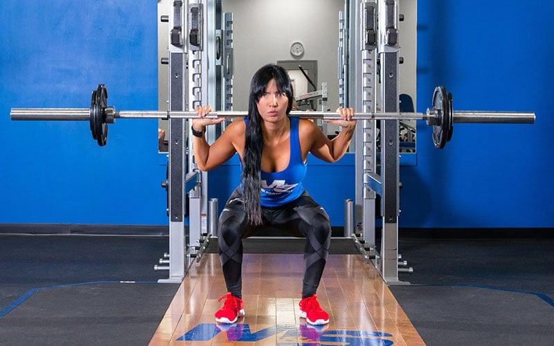 Female Athlete Performing Squats