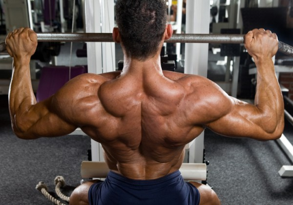 Bodybuilder performing lat pulldowns for hypertrophy.