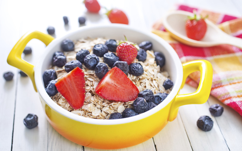 Bowl of oatmeal topped with fresh fruit