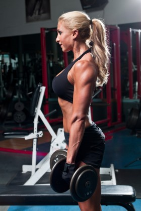 Woman Performing Dumbbell Curls