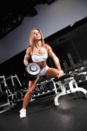 Woman performing dumbbell rows.