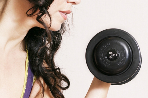 Many women fear that picking up a dumbbell will turn them into Arnold.