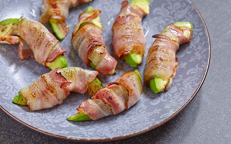 Bacon wrapped avocado slices