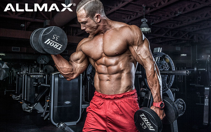 Team Allmax Athlete Performing Dumbbell Curls