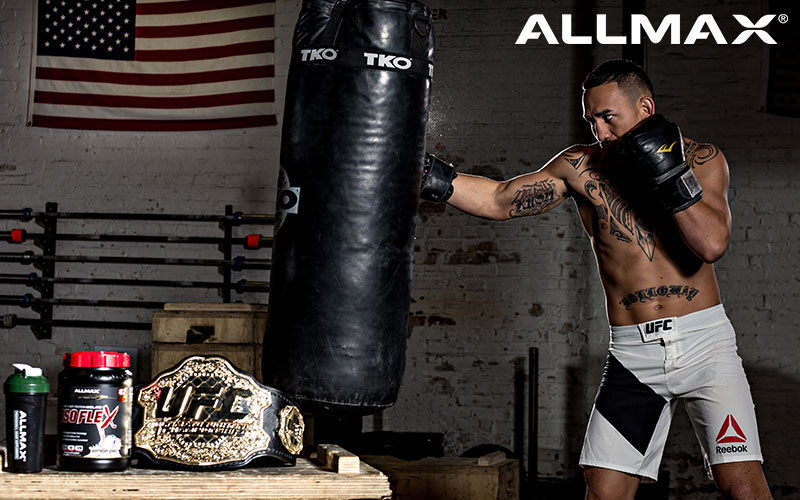 Allmax Athlete Throwing a punch