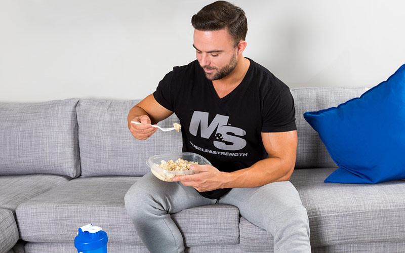 Male Bodybuilder Eating Chicken and Rice