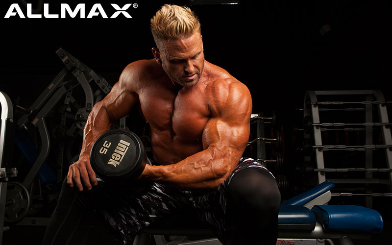 Allmax Athlete Performing Concentration Curls