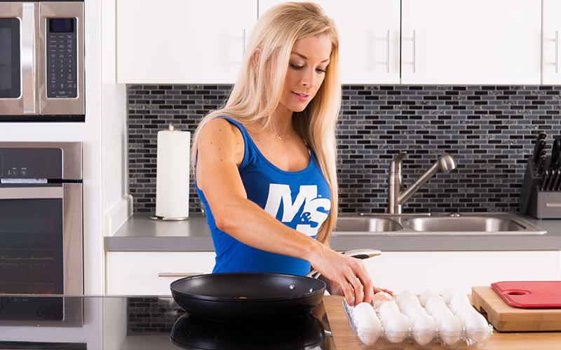 M&S Female Athlete Cracking Eggs
