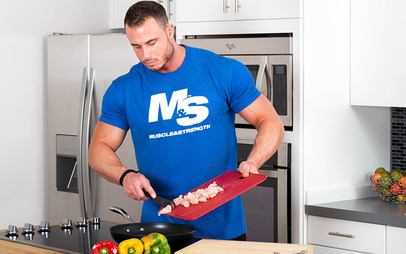 M&S Athlete Cooking Food in the M&S Kitchen While Wearing a M&S Shirt