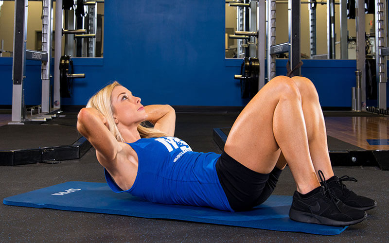 Femal Muscle and Strength Athlete Performing a Crunch