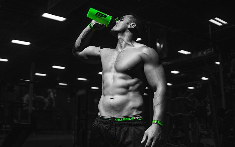 Man Drinking from Blender Bottle