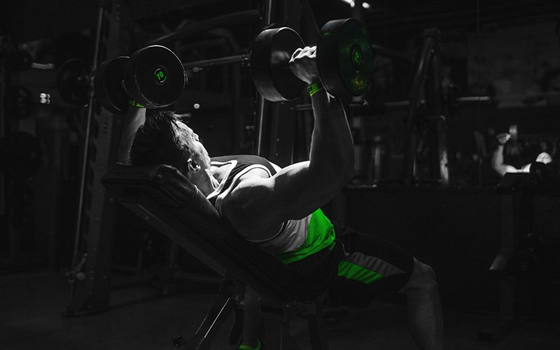 Man performing Incline Dumbbell Press