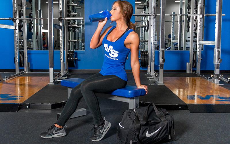 M&S Female Athlete Drinking Protein