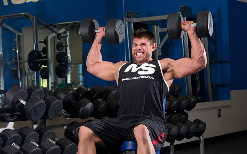 M&S Athlete Performing Dumbbell Shoulder Press