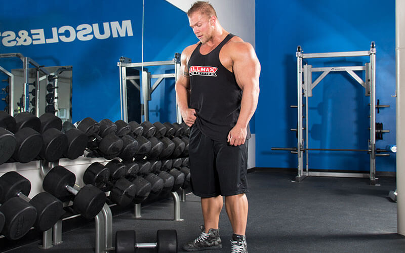 M&S Athlete Selecting Dumbbells For Exercise