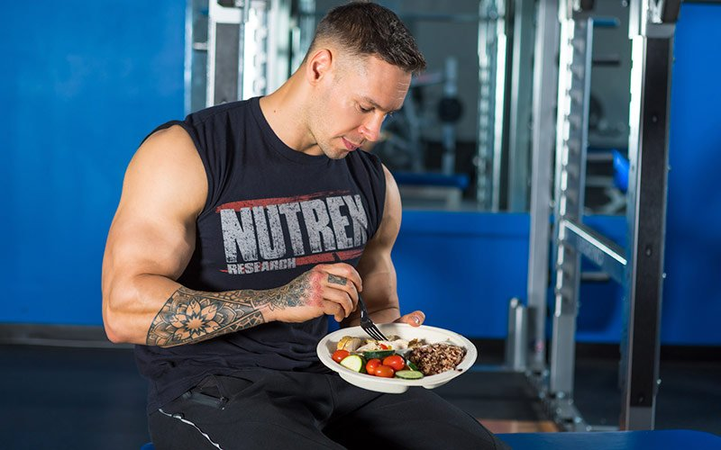 Nutrex athlete enjoying a home cooked meal