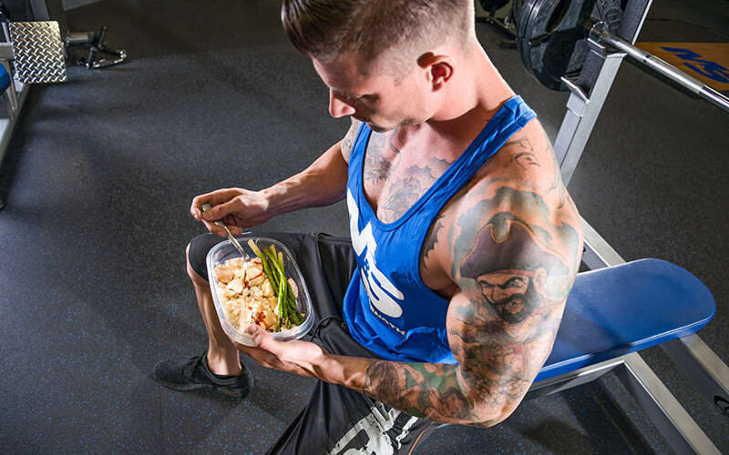 M&S Athlete Eating a Meal Prepped Meal in the Gym