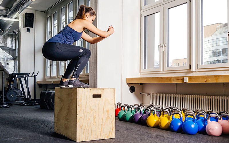 Girl performing Box Jumps for Plyometric exercises