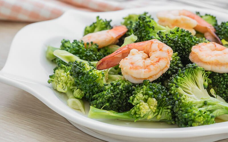 shrimp over broccoli with healthy fats as part of the Zone Diet