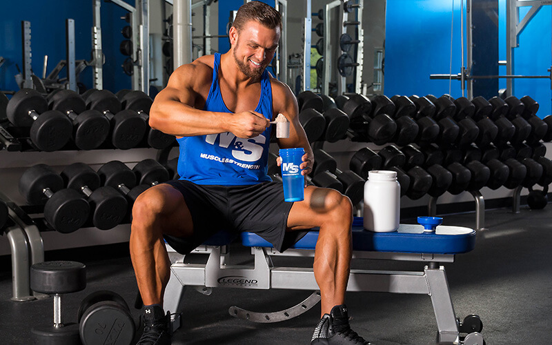 M&S Athlete Scooping Protein into Shaker Cup