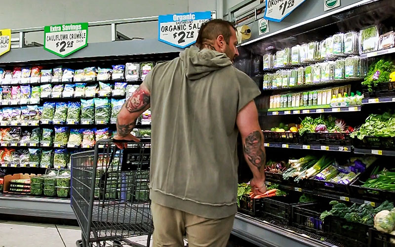 Kris Gethin Shopping for Veggies in the grocery store