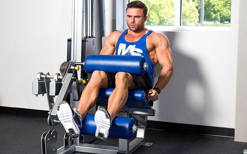 M&S Athlete Performing Seated Leg Curls