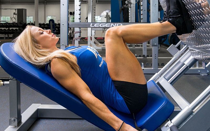 Female Athlete Performing Leg Press