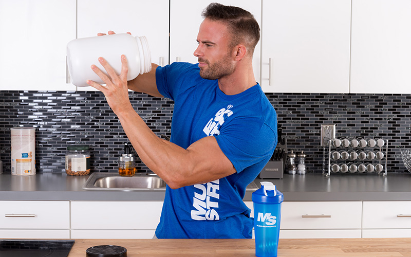 M&S Athlete Looking into a tub of protein