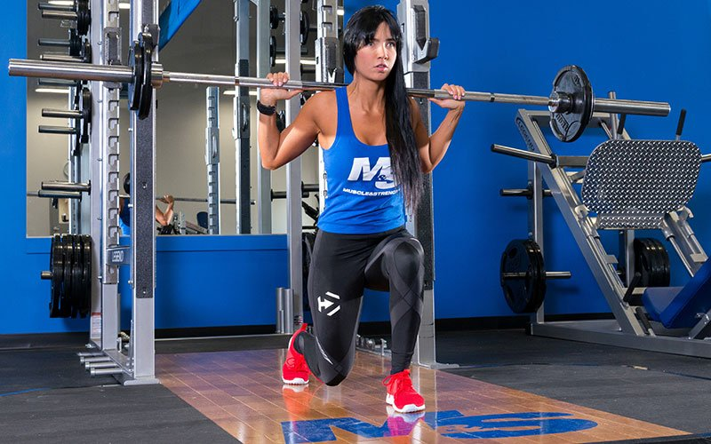 Dymatize Female Athlete Performing a Lunge