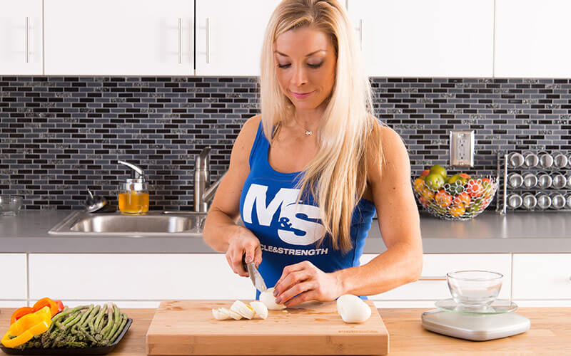 M&S Female Athlete meal prepping food to fuel her body