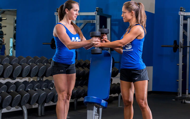 11 Mindset Tips, 2 female athletes lifting together and creating a support system