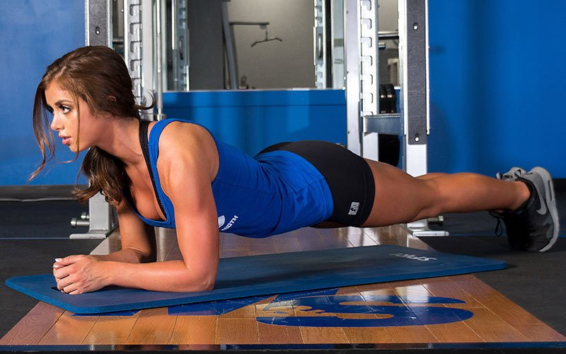 M&S Athlete Training Her Core by Performing Planks